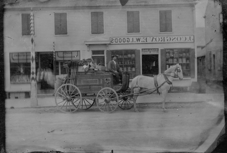 Peddler and Wagon in front of John Cosgrove, grocer in Lowell, MA